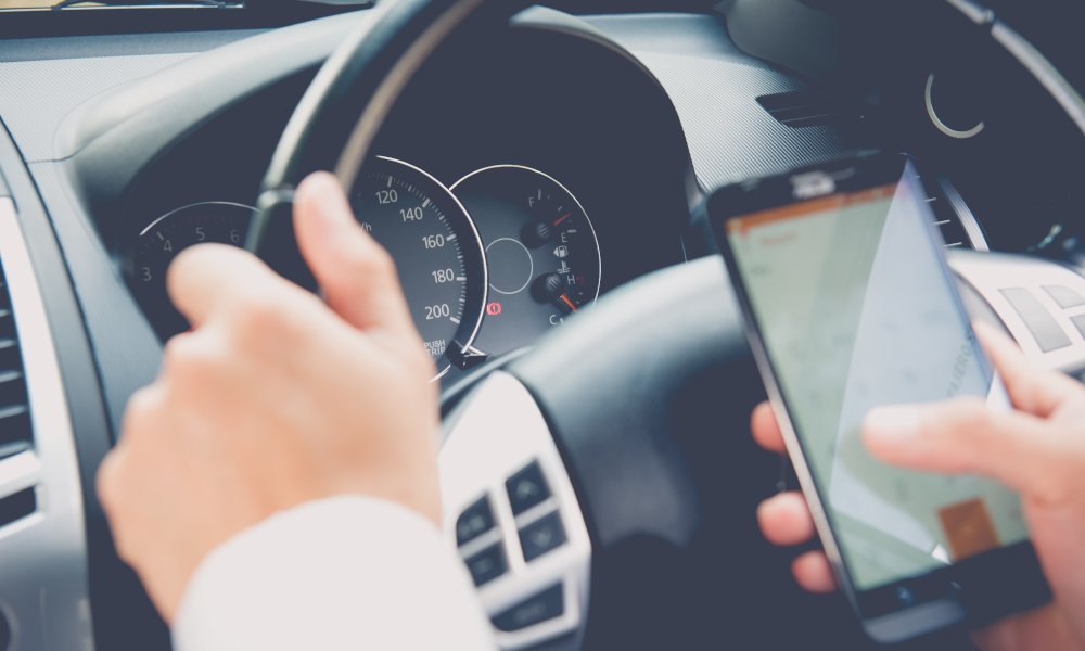 phone driving stock image