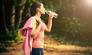 woman-drinking-water-after-exercise-stock-image
