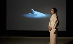 Artist Fuyoko Matsui pictured in the exhibition Japan supernatural with her work Regeneration of a breached thought 2012.
